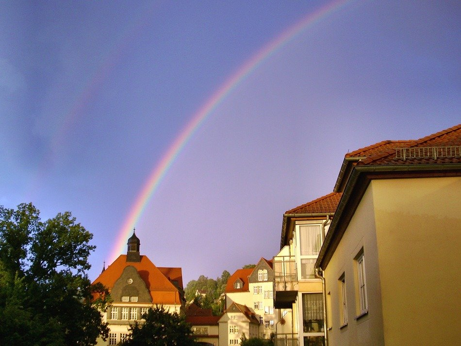 rainbow over old city after rain