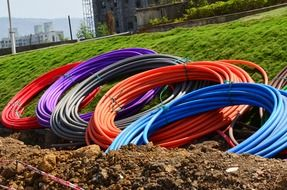 colorful pipes in coils on ground