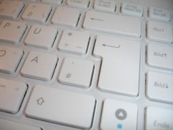 photo of part of a white computer keyboard