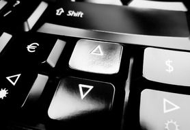 Closeup photo of black and white keyboard