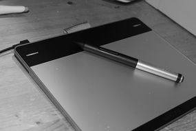 tablet with pen on office desk