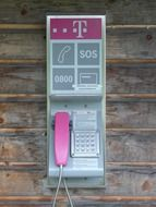 telephone booth with pink telephone