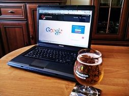 beer and laptop on the table