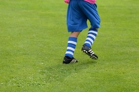 boy playing football on the field