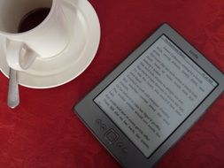 kindle e-book and cup of coffee
