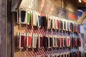 colorful iphone cases on stand
