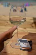 phone and wine glass