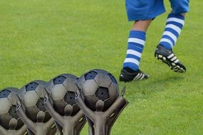 Football rewards against the background of footballer's legs