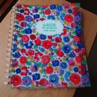 notebook with colorful flowers