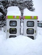 telephone booths in deep snow in austria
