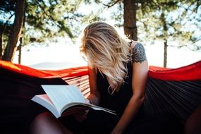 blonde woman reading book read at nature