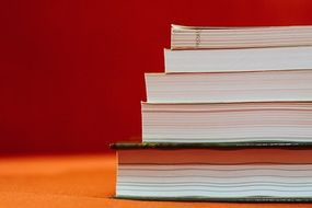 books stack at red background