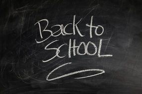 inscription on a blackboard about return to school