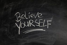 inscription on a blackboard about self confidence