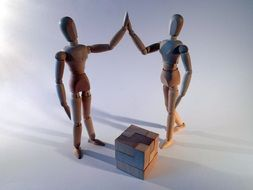 two wooden dolls and puzzle