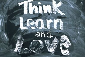 inscription on a blackboard about think, learn, love structure