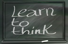 blackboard with text learn to think