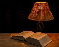 book in the light of a lamp