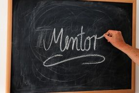 inscription MENTOR on a blackboard