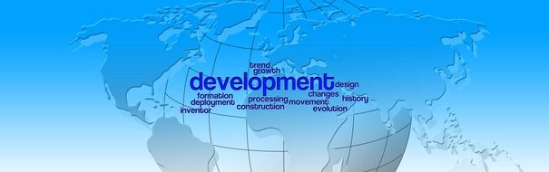 Development sign on the globe