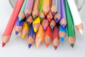 sharpened colour pencils in a glass