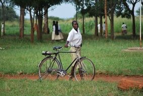 african student with bike in the park