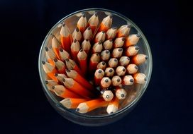 orange pencils in glass