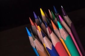 colored pencils on a dark background