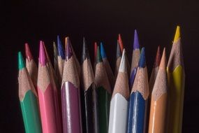 wooden pegs colored pencils