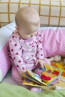 small baby reading book