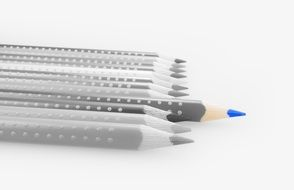 Pencil with blue core on black and white background of colored pencils