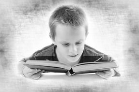 black and white photo of a boy with a book