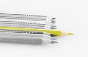 yellow pencil on black and white background of colored pencils