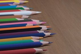 A set of colored sharpened pencils on the table