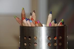 color pencils in a pen holder