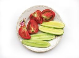 Cutted tomatoes and cucumbers on a plate