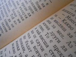 macro shot of book page with letters