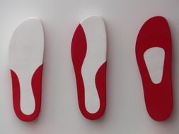 three insoles from sneakers