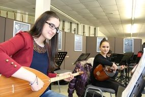 girls with musical instruments in music lesson