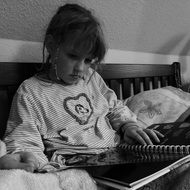 Black and white photo of the child who is reading