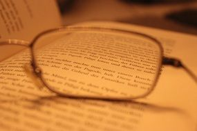 eye glasses on the opened book