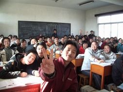 happy asian students in classroom