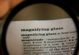 text under a magnifying glass