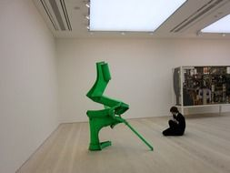 student sketching modern art object in gallery, uk, england, london