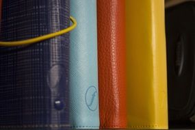 Notebooks in the colored covers
