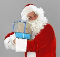 Santa Claus with gifts in his hands
