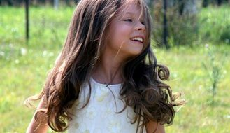 girl with long hair smiling