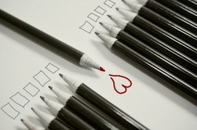 red pencil and painted heart, simple pencils and drawn squares