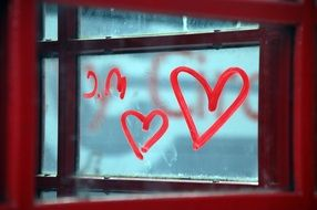 heart drawing jn the glass