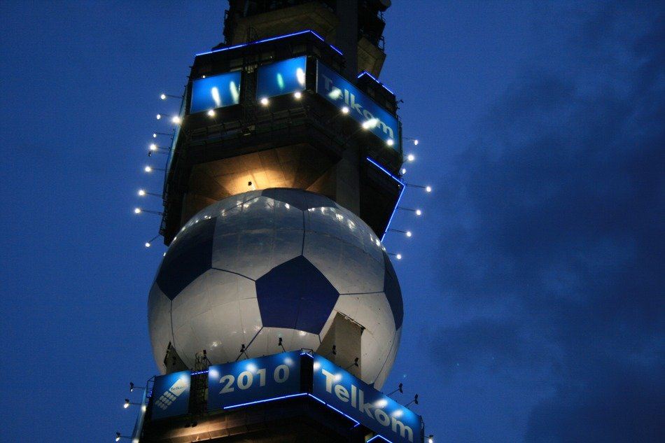 soccer ball as part of a television tower at night